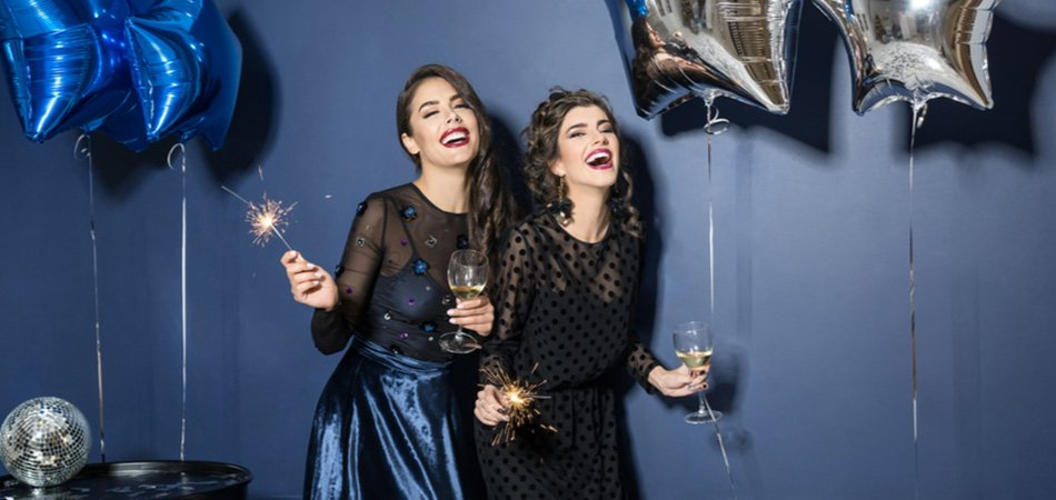 Two young women in party dresses