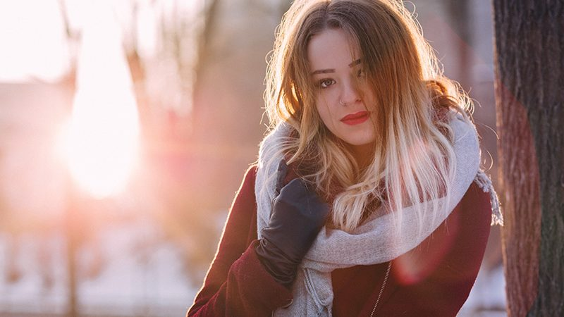 Young woman in warm scarf | avoid a cold