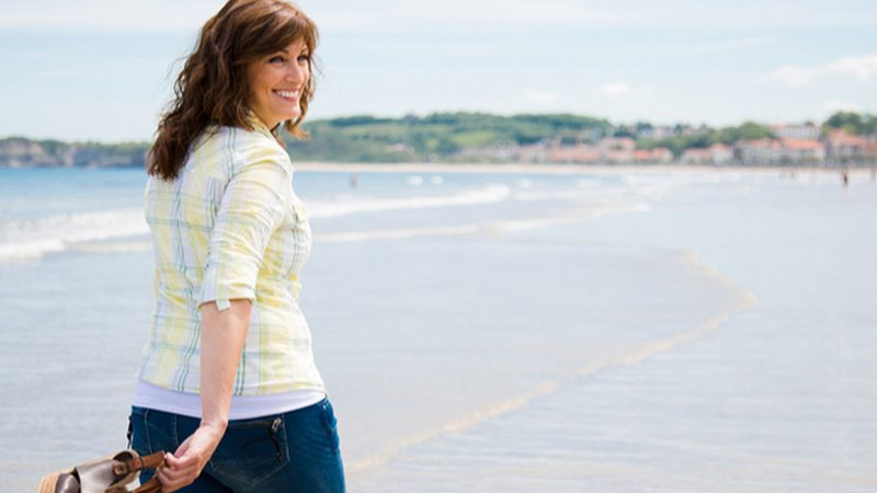 woman on a beach | herbal water retention tablets