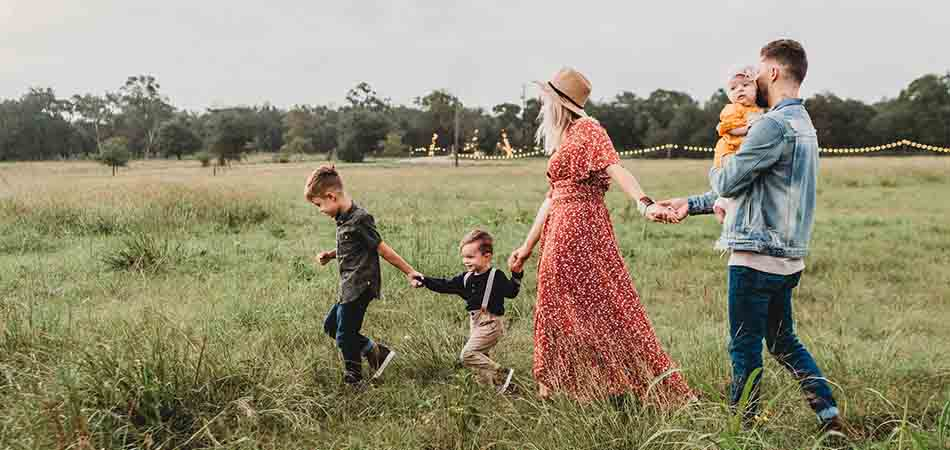 Family relaxing in a field | managing stress and anxiety