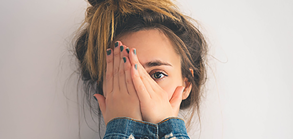 Young woman worrying how to get rid of spots